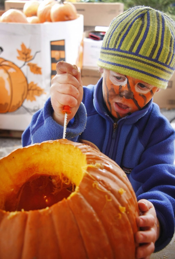 Peter Towne, 5, of Freeport tries his hand at carving.
