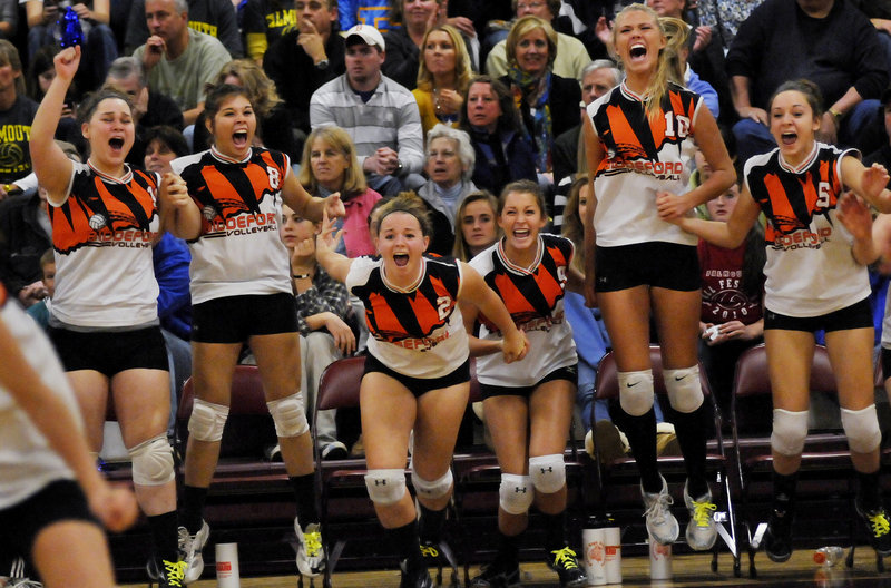 Players on the Biddeford bench erupt into a celebration after the final point. The Tigers knocked off perennial power Greely in the semifinals.