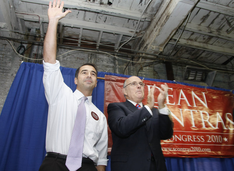 First District congressional candidate Dean Scontras waves to the crowd as he is joined by former New York Mayor Rudy Giuliani at a rally in Portland on Saturday.