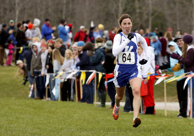 Abbey Leonardi of Kennebunk sprints to the finish to win Class A for the third straight year, just missing a course record.