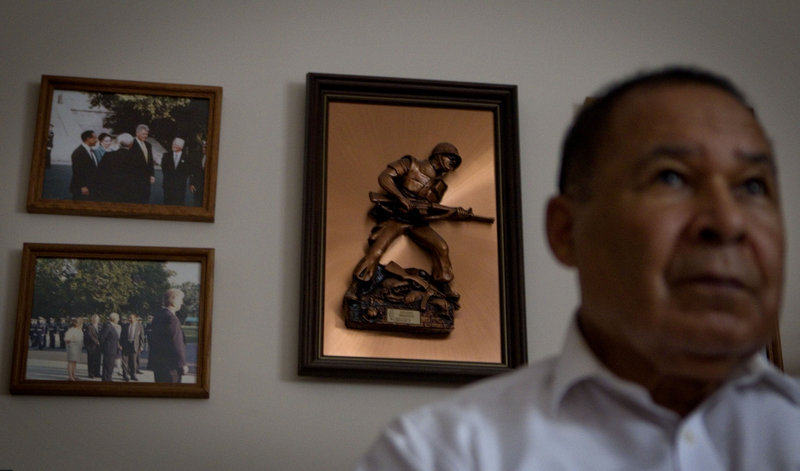 A plaque of a Marine hangs in the Fayetteville, Ga., home of Thomas J. Woods, 78, a Marine veteran of the Korean War. The stories of Woods and other black veterans who served among the military's first desegregated units offer a history lesson amid the debate over gays in the military.