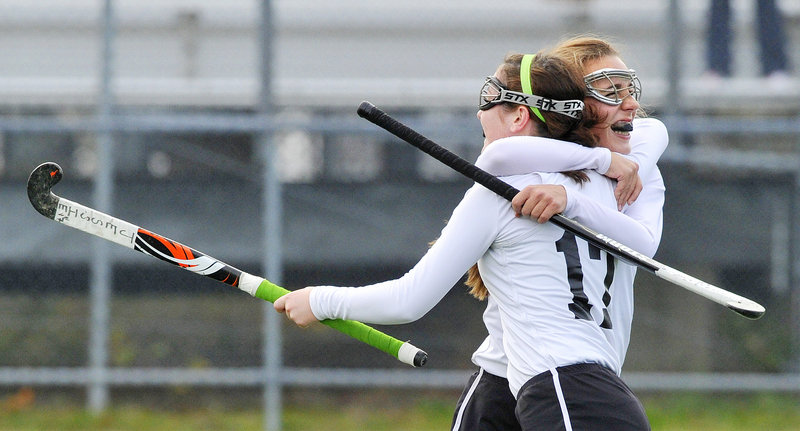 Jessica Skillings, front, gets a congratulatory hug after scoring one of her two goals Saturday for Skowhegan in a 3-0 victory over Cheverus in the Class A state field hockey final at Orono. Skowhegan finished 18-0 with just two seniors on the team.