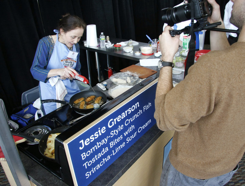 Jessie Grearson of Falmouth uses an internal thermometer as she creates her appetizer at the Hood dairy cook-off.