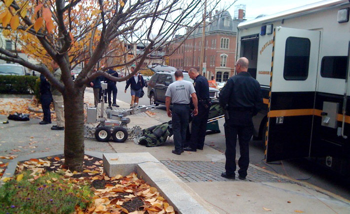 Police bomb specialists pack up their equipment after the bomb scare at the federal courthouse today.