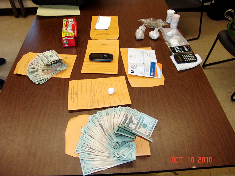 A South Portland Police photo of money and drugs seized in the bust.
