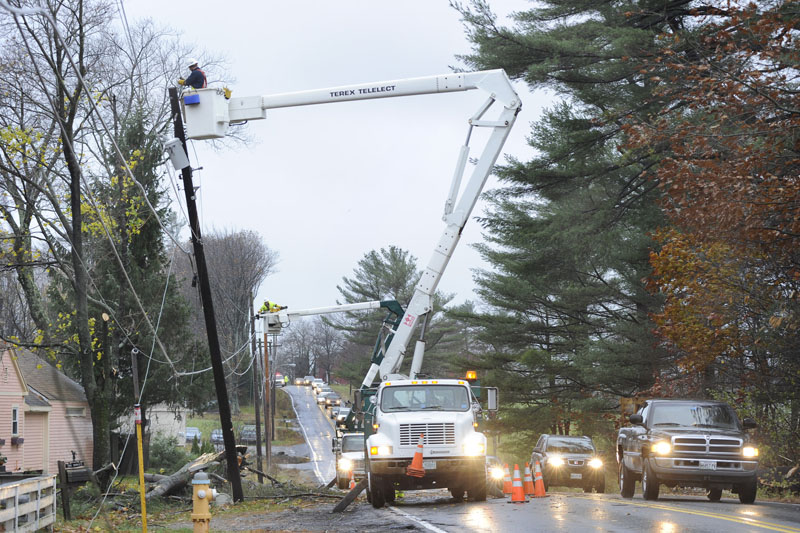 Route 22 on the Scarborough/Westbrook line has re-opened to one lane after trees knocked down power lines. Utility crews like this one are busy all over Maine restoring power for up to 50,000 residents.