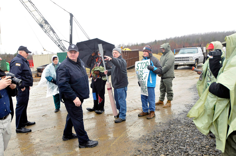 Staff Photo by Shawn Patrick Ouellette: Protesters gathered at the Rollins wind energy project in Lincoln listen to the police as they ask them to move of Rollin's property Monday, Nov. 8, 2010.