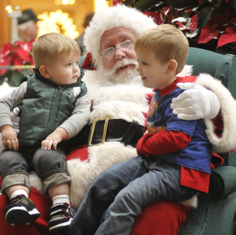 Staff Photo by Shawn Patrick Ouellette: Daniel Barry , 23 months and Patrick Barry 4, of Sidney, talk with Santa during a trip to the Maine Mall Monday, Nov. 15, 2010.
