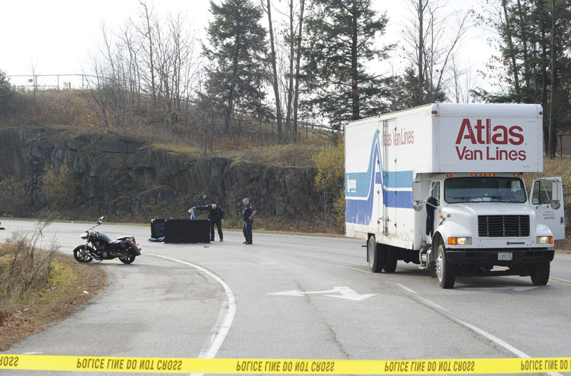State and Portland police at the scene of a fatal motorcycle and moving truck accident at Skyway Drive and Congress Street in Portland this morning.