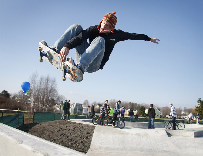 Chris Peterson of Winthrop flies overhead as the new Portland Skate Park opens at Dougherty Field on St. James Street in Portland today.