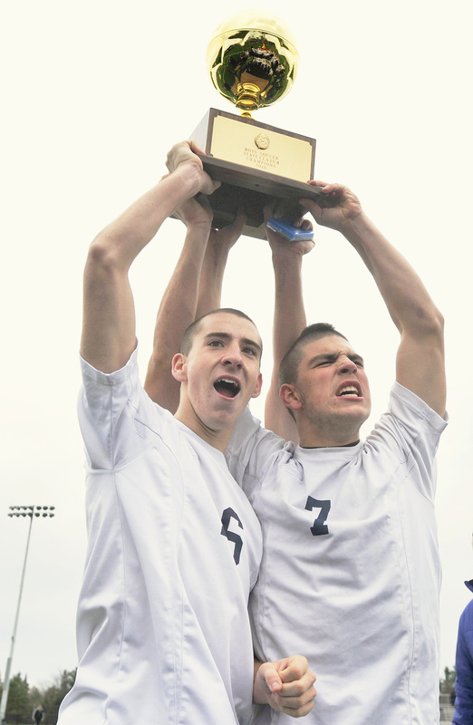 Yarmouth team captains Kyle Groves, left, and Campbell Belisle-Haley celebrate their team's Class B state championship win over Ellsworth today.