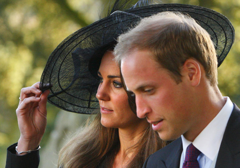 In this Oct. 23, 2010 file photo, Britain's Prince William and Kate Middleton leave the wedding of their friends Harry Mead and Rosie Bradford in the village of Northleach, England. According to an announcement from Clarence House in London, Tuesday Nov. 16, 2010, the couple are engaged, and will be married in 2011.