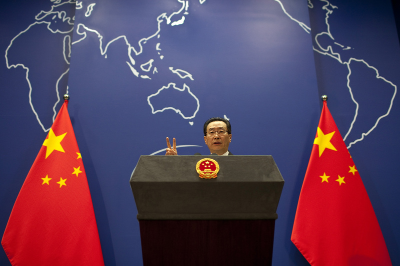 Chinese Vice Foreign Minister Wu Dawei gestures while speaking at a press briefing in Beijing today. The Chinese envoy called for an emergency meeting of North Korean nuclear disarmament talks to discuss the tensions on the Korean peninsula.