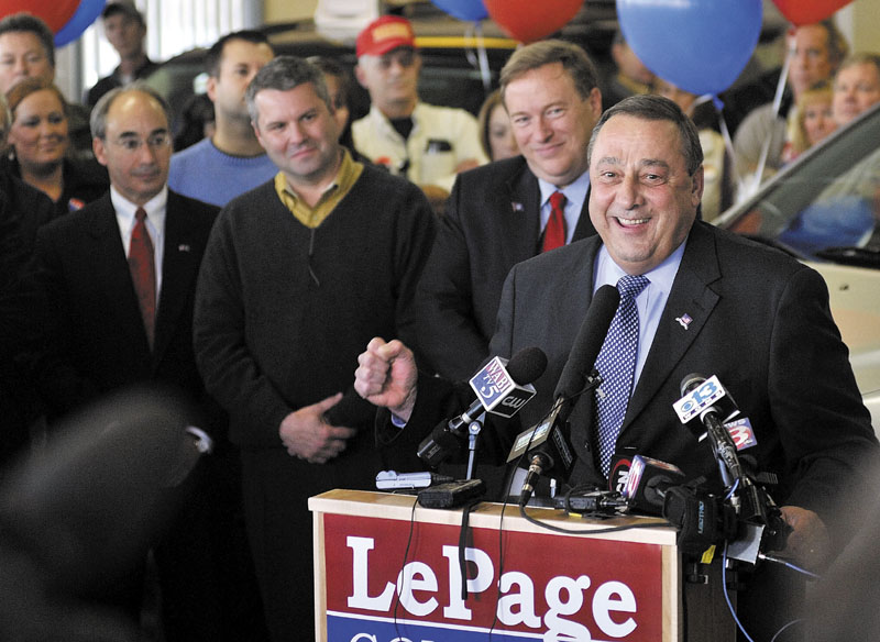 Gov.-elect Paul LePage speaks at a news conference in Waterville Nov. 3. Behind LePage, from left, are former gubernatorial candidate Bruce Poliquin, state Sen. Jon Courtney and state Sen. Kevin Raye.