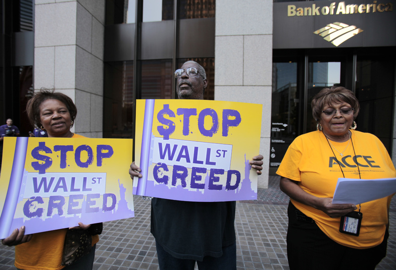 Members of Alliance of Californians for Community Empowerment protest outside Bank of America offices to demand banks' accountability, a foreclosure moratorium and loan modifications. From left are Betty Steele, Mabdullah Mohamed and Lyneva Mottley.