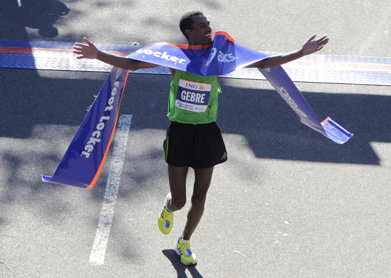 Gebre Gebremariam, of Ethiopia, crosses the finish line first in the men's division at the 2010 New York City Marathon in New York today. Gebremariam won the men's title at the New York City Marathon in his debut at the distance.