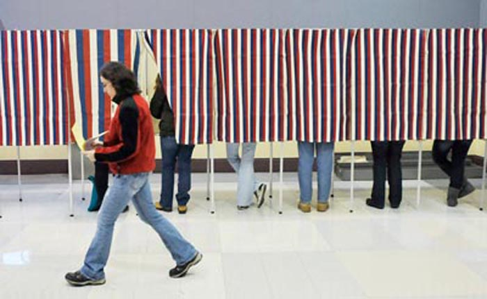 Portland residents cast their votes at the Merrill Auditorium Rehearsal Hall in Portland today.