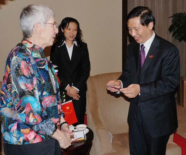 From left: Theodora Kalikow, president of the University of Maine at Farmington, is assisted by a translator as she is welcomed to China by Guo Guangsheng, president of Beijing University of Technology.