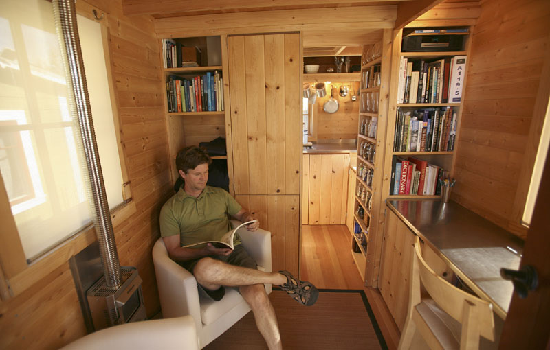Jay Schafer sits in one of the homes he built for himself in Graton, Calif.