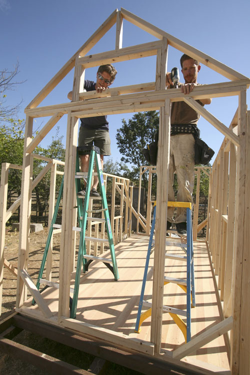 Jay Schafer, owner of Tumbleweed Tiny Houses, left, works on construction of a frame with worker Zeke Gifford in Graton, Calif.