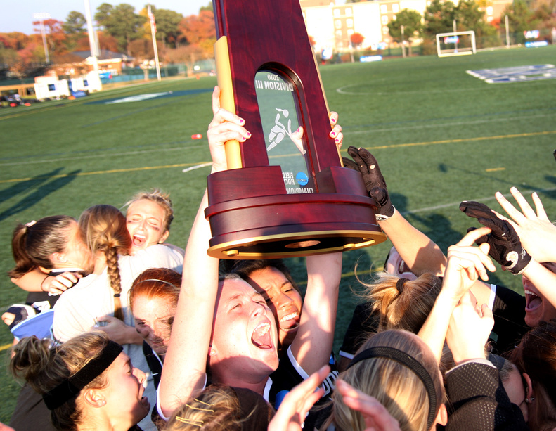 The Bowdoin College field hockey team celebrates after beating Messiah College on penalty strokes Sunday to reclaim the NCAA Division III title at Newport News, Va. The shootout broke a 1-1 tie after regulation and two overtime periods.