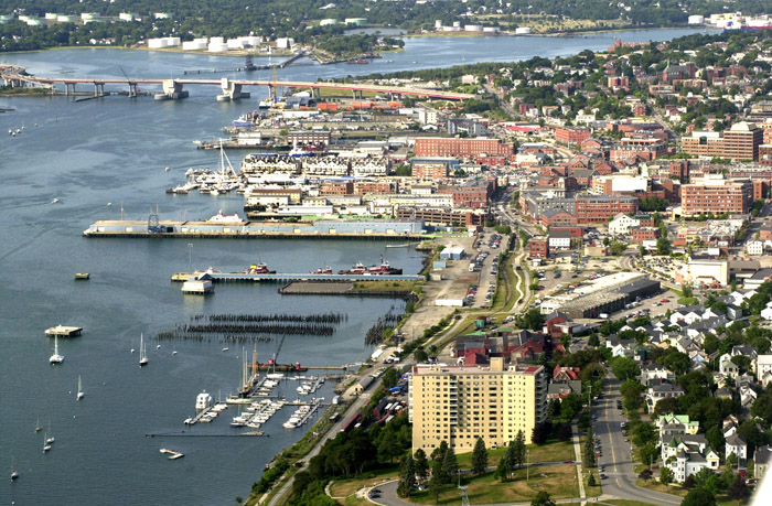 Aerial view of Portland waterfront looking west to Casco Bay Bridge. How proposed zoning changes are implemented could the working waterfront into a sterile commercial district – downtown with water views.