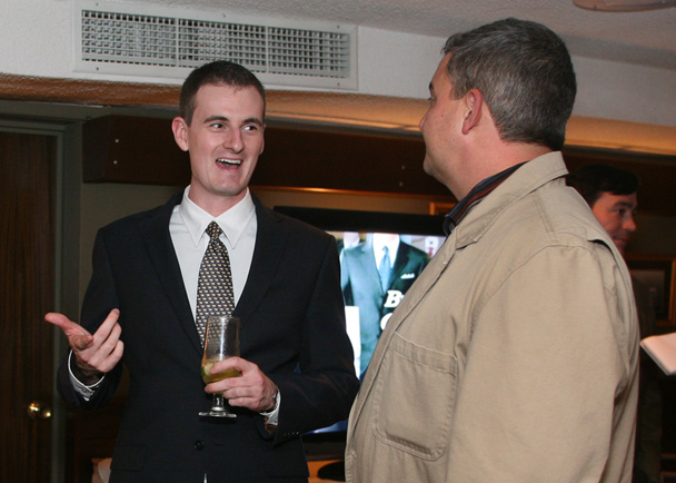 Chase Martin, Republican candidate for House District 115 in Portland, left, visits with Mark Ferguson of Poland Springs, during the Yes on 1 Four Season Resort and Casino reception at DiMillos Floating Restaurant in Portland.