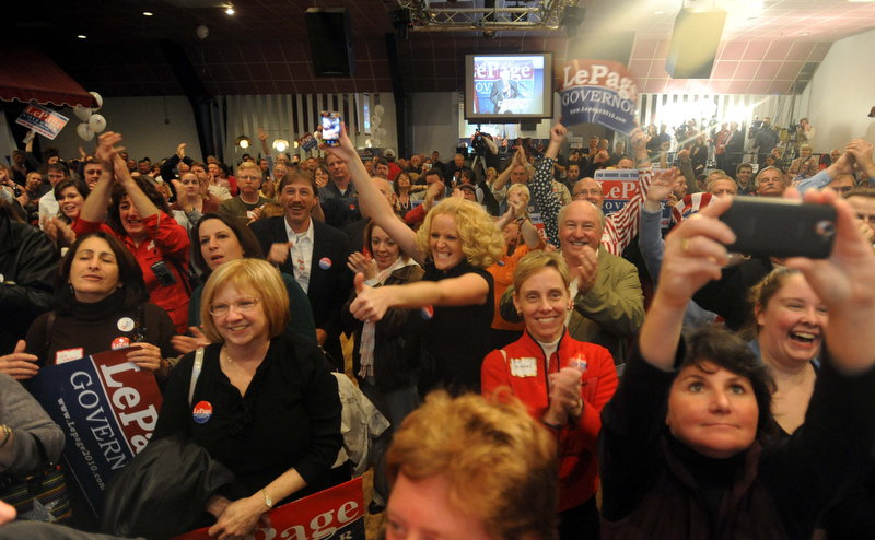 Staff photo by Michael G. Seamans Paul LePage supporters cheer as poll numbers roll in at the election night party at Champions in Waterville Tuesday night.