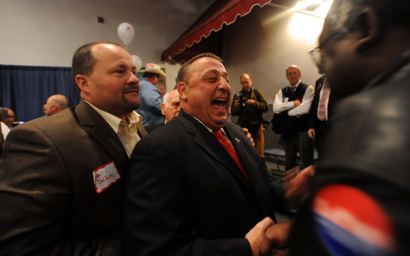 Staff photo by Michael G. Seamans Paul LePage supporters watch as poll numbers roll in at the election night party at Champions in Waterville Tuesday night.