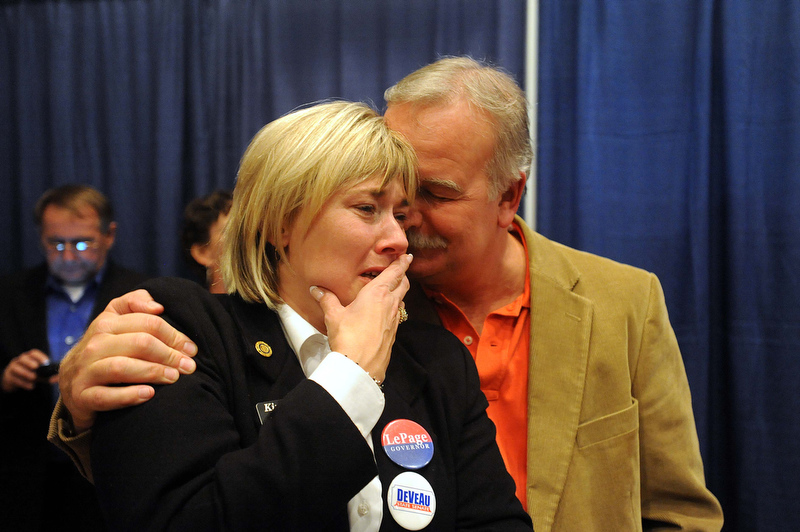 Staff photo by Michael G. Seamans Kim Lindlof, finance director gets emotional as the Paul LePage takes the lead in the race for governor early Wednesday morning at Champions in Waterville.