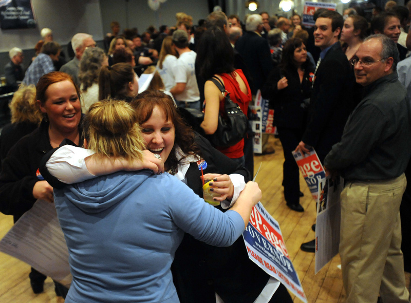Staff photo by Michael G. Seamans Supporters celebrate as poll numbers roll in at the Paul LePage election night party at Champions in Waterville early Wednesday morning.