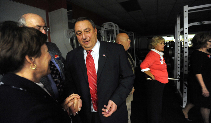 Staff photo by Michael G. Seamans Paul LePage takes a moment behind the scenes as supporters rally at the election night party at Champions in Waterville Tuesday night.