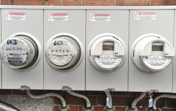 The new smart meters at right are replacing the older meter style at left.