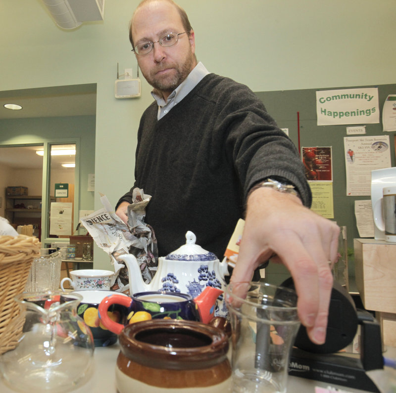 Reporter Ray Routhier unpacks and sorts items at the Freeport Community Center Thrift Shop.