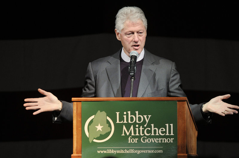 Former President Bill Clinton, speaking at a rally at the Lewiston Armory on Sunday, said Maine's Democratic candidates are caught in the gap between when good things are done and when people begin to feel it.