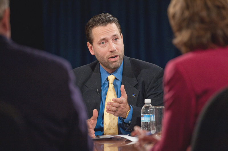 Joe Miller, Republican candidate for U.S. senator in Alaska, makes a point in a debate last week. Miller has admitted lying about using government computers for political work.