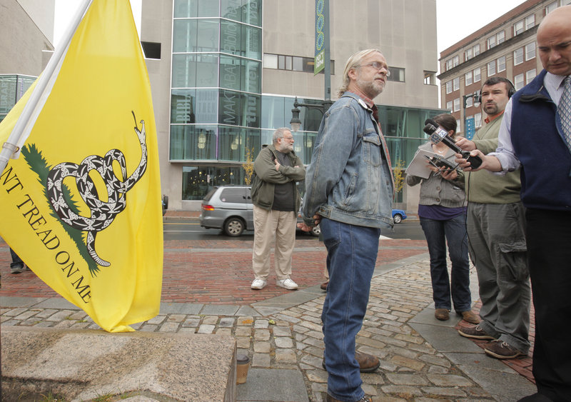 Pete Harring of Standish, head of the Maine ReFounders, a tea party organization in Maine, speaks during a news conference in Monument Square on Thursday.