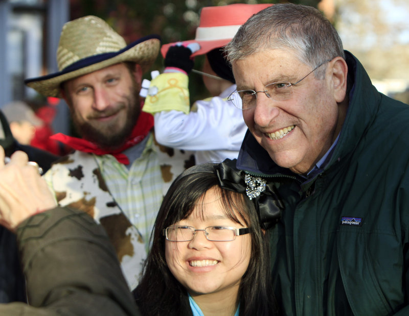 Eliot Cutler poses for photographs while campaigning at a Halloween parade in Brunswick on Sunday.