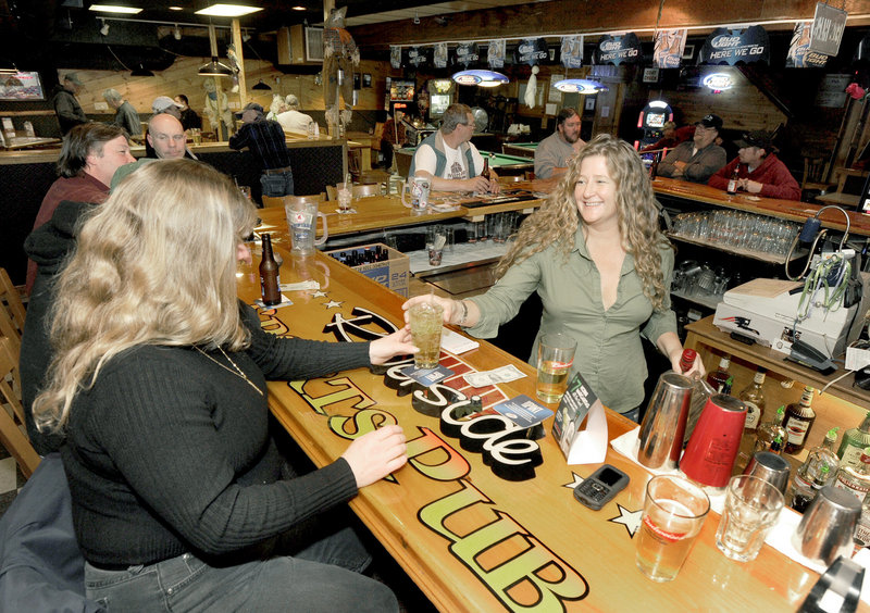 Bartender Misty Fisher serves customers at Riverside Sports Pub in Bath.