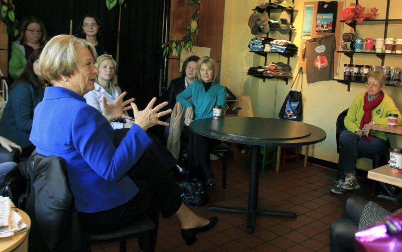 Democrat Libby Mitchell meets with supporters at Coffee By Design on India Street in Portland on Monday to talk about the needs of Maine's business community.