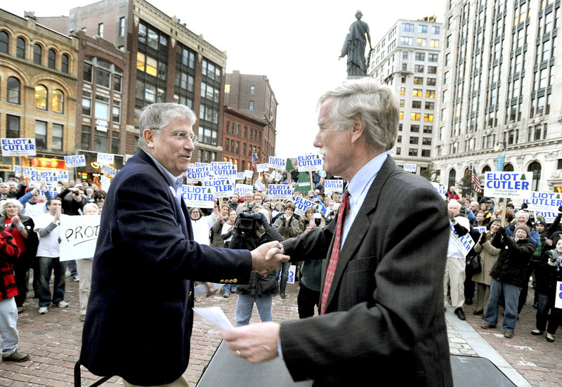 Independent candidate Eliot Cutler is introduced by former Maine Gov. Angus King, who also won as an independent, at a rally Monday afternoon in Portland's Monument Square.