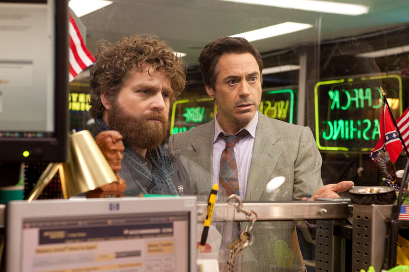 Trouble finds Galifianakis and Downey – again and again.
