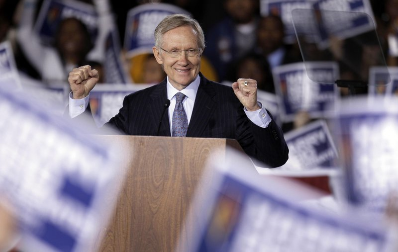 Harry Reid, the Senate majority leader, acknowledges supporters at a rally Monday in Las Vegas. Like many other Democrats, he is locked in a tight race for re-election, facing a tough challenge in Nevada from tea party Republican Sharron Angle.