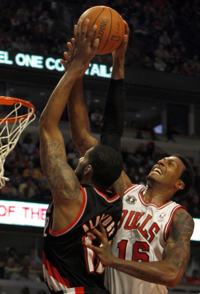 Portland's LaMarcus Aldridge, left, is fouled by Chicago's James Johnson during the first half Monday night in Chicago. The Bulls beat the Trail Blazers, 110-98.