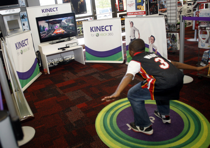 Michael McKoy, 11, checks out the Kinect sensor system on an XBOX 360 at a Charlotte, N.C. Gamestop. Microsoft's new sensor lets users control games through body motions, similar to Nintendo's Wii system.