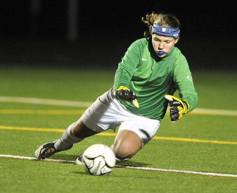 John Ewing/Staff Photographer Falmouth goalkeeper Elizabeth Estabrook learned how to play on turf when the Yachtsmen opened their new field a month ago. But now it will be back to a grass field when Falmouth travels to York for the Western Class B girls' soccer championship game tonight.