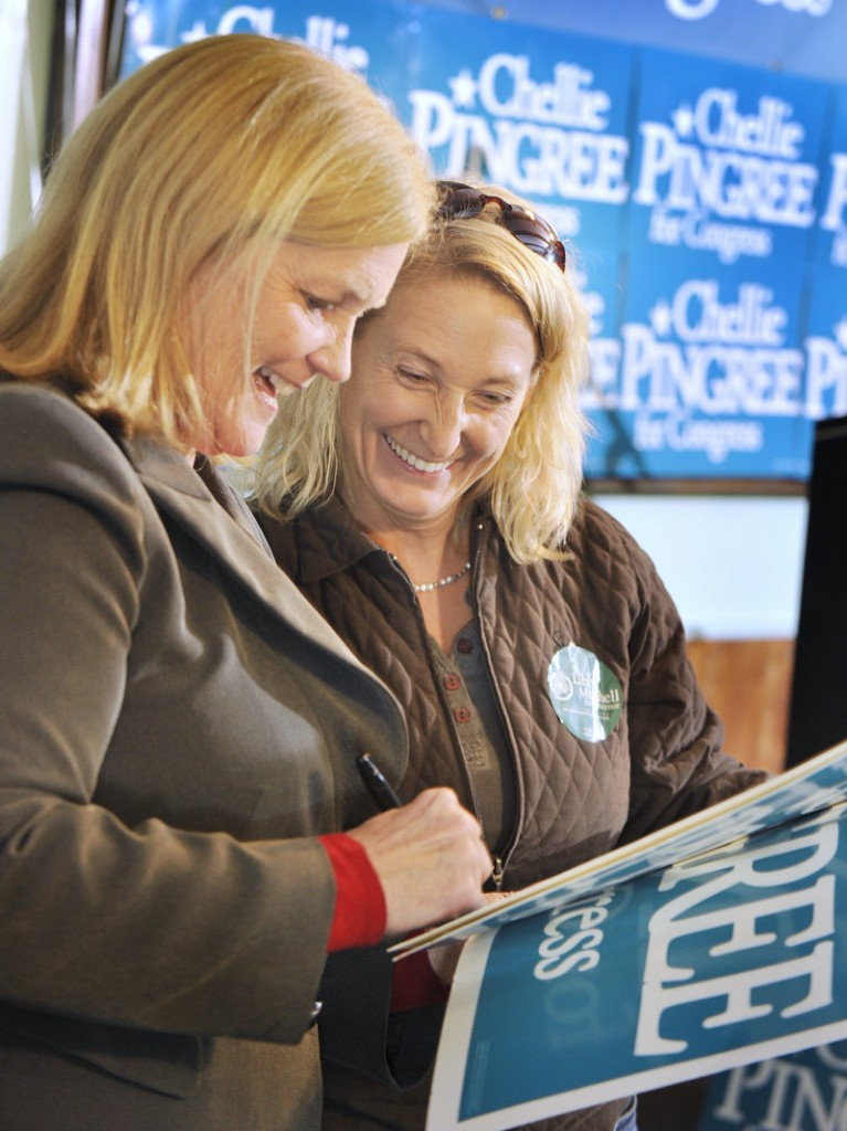 Newly re-elected U.S. Rep. Chellie Pingree of Maine's 1st District autographs a campaign poster for Melanie Collins of Falmouth following her win.
