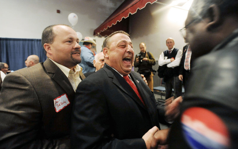 Gov.-elect Paul LePage celebrates with supporters in Waterville as the votes were being counted Tuesday night.