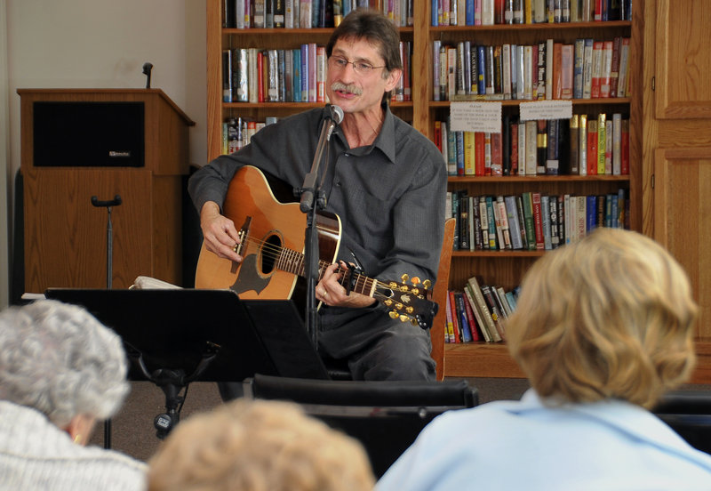 Dave Fisher plays guitar and sings for residents of Wardwell Nursing Home in Saco. Fisher overcame stage fright and now plays more than 400 shows a year.