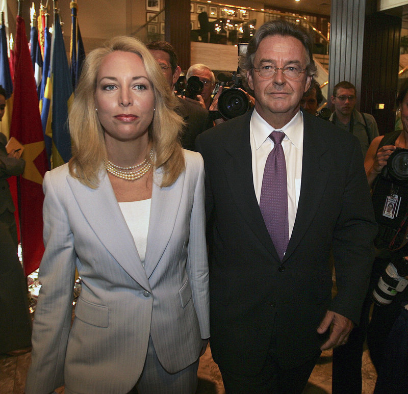 """Former CIA agent Valerie Plame and her husband, former ambassador Joe Wilson, arrive at the National Press Club in Washington in this July 14, 2006, file photo. """"I have found it a real challenge to be a public person,"""" Plame Wilson said in an interview this week from Santa Fe, N.M., where she now lives with her husband and their 10-year-old twins."""